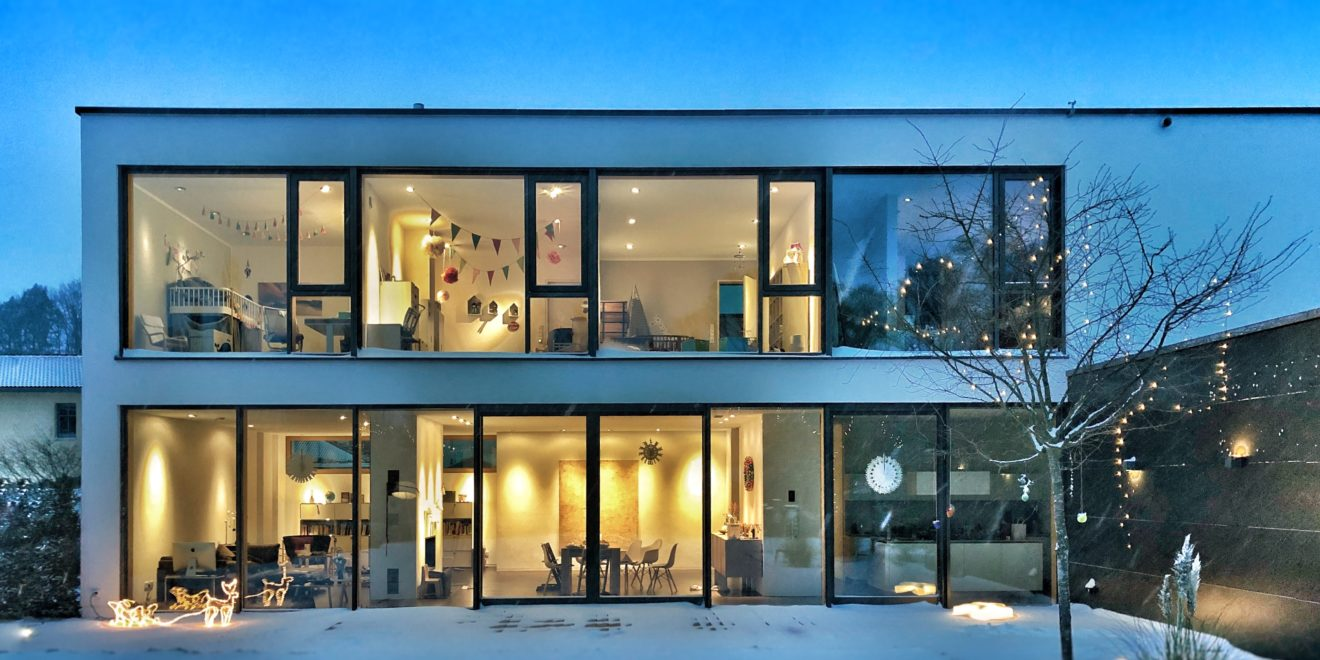 Warm, bright glass house in the winter