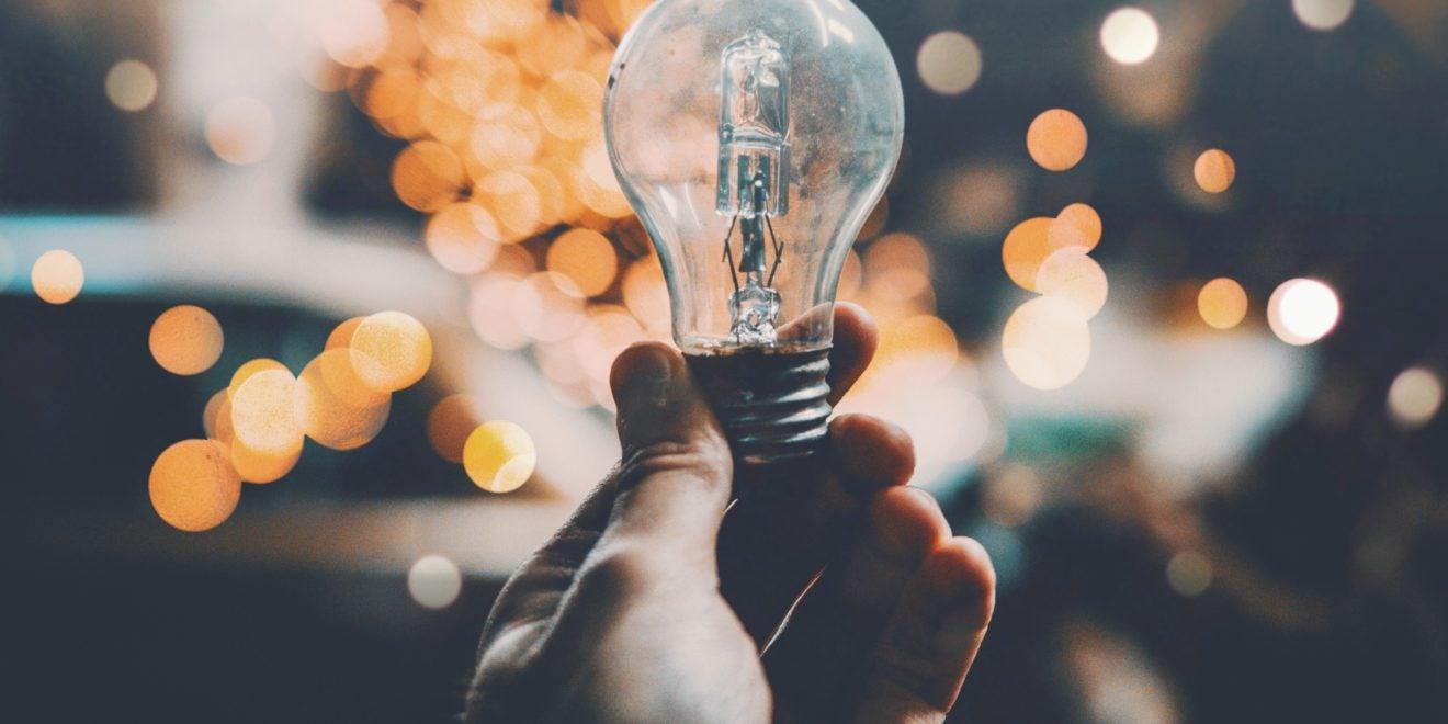 insurance agent holding a light bulb